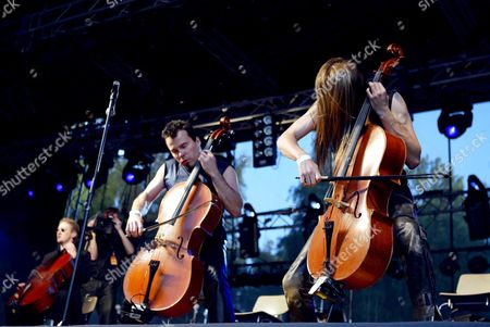PAAVO LOTJONEN AND EICCA TOPPINEN OF APOCALYPTICA WHO PLAY HEAVY METAL ROCK MUSIC ON CELLOS
