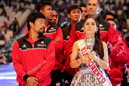 Manny Pacquiao (L) and his wife Jinkee Pacquiao (R) the basketball team Kia Sorenta on the 40th season opening of the Philippine Basketball Association (PBA)