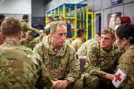 General Tim Radford, who commands the 44,000 men and women who support army operations, talks to some of the medics.