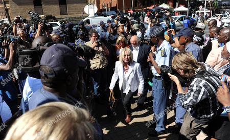 Reeva Steenkamp's parents June and Barry Steenkamp arrive at the Pretoria High Court