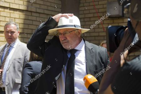 Stock Photo of Oscar Pistorius's father Henke Pistorius leaves the Pretoria High Court after sentencing