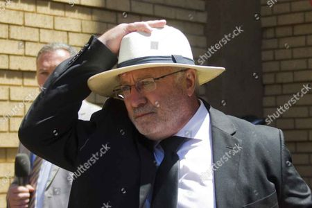 Stock Image of Oscar Pistorius's father Henke Pistorius leaves the Pretoria High Court after sentencing