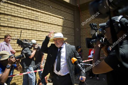 Oscar Pistorius's father Henke Pistorius leaves the Pretoria High Court after sentencing