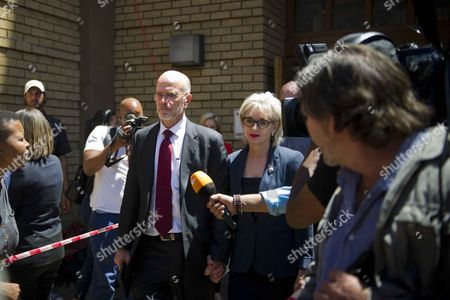 Arnold and Lois Pistorius leave the Pretoria High Court after sentencing