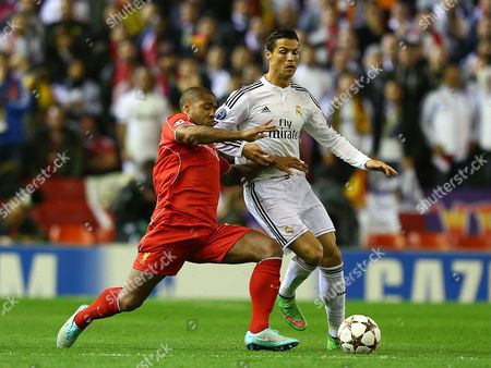 Stock Picture of Glen Johnson of Liverpool tackles Cristiano Ronaldo of Real Madrid