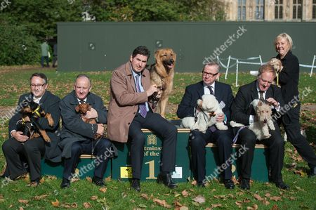 Martin Horwood, Laurence Robertson with Sausage, Rob Flello with Diesel and Michael Gove with Snowy, Simon Reevell