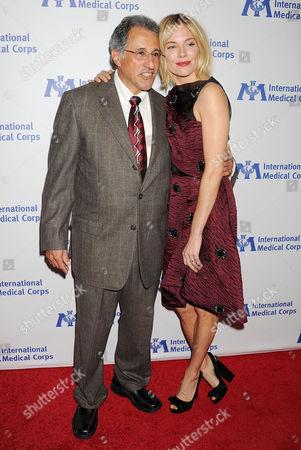 Dr. Bob Simon and Sienna Miller