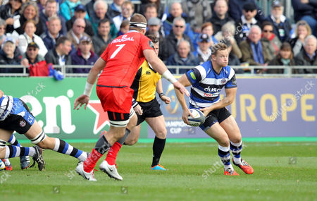 Chris Cook of Bath Rugby tries to escape from Imanol Harinordoquy of Toulouse (L)  Bath v Toulouse - 25/10/2014 - European Rugby Champions Cup - The Recreation Ground, Bath - UK  Andrew Fosker / Seconds Left Images / Rex