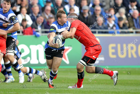 Chris Cook of Bath Rugby tries to escape from Imanol Harinordoquy of Toulouse Bath v Toulouse - 25/10/2014 - European Rugby Champions Cup - The Recreation Ground, Bath - UK  Andrew Fosker / Seconds Left Images / Rex