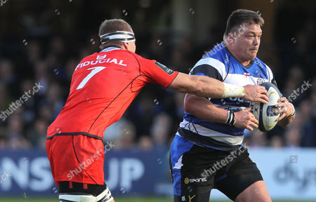 David Wilson of Bath Rugby goes past Imanol Harinordoquy of Toulouse