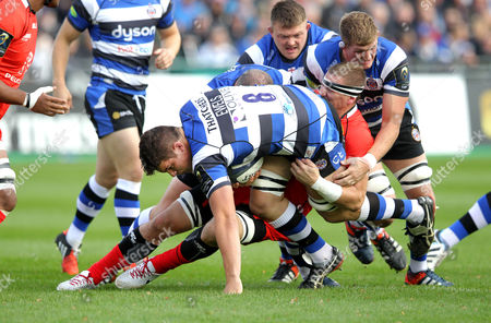 Charlie Ewels of Bath Rugby is tackled by Imanol Harinordoquy of ToulouseBath v Toulouse - 25/10/2014 - European Rugby Champions Cup - The Recreation Ground, Bath - UK  Andrew Fosker / Seconds Left Images / Rex