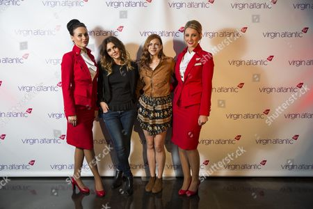 Alexandra Chando and Allie Genino with cabin crew