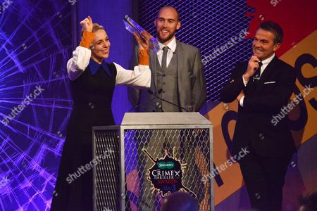 Amanda Abbington collects the award for Best Supporting Actress for Sherlock with award presenter Joe Sims and host Bradley Walsh