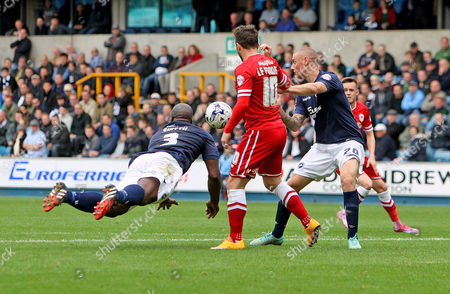 Danny Shittu clears for Millwall with a diving header.