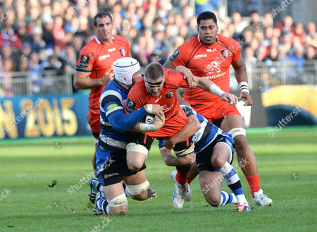 Stock Photo of Imanol Harinordoquy of Toulouse is tackled by (R) George Ford