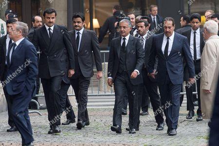 Qatar's Emir Sheikh Tamim bin Hamad Al Thani and his brother Qatar's Shiekh Joaan bin Hamad bin Khalifa al-Thani
