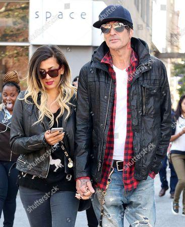 Stock Image of Tommy Lee and fiance Sofia Toufa