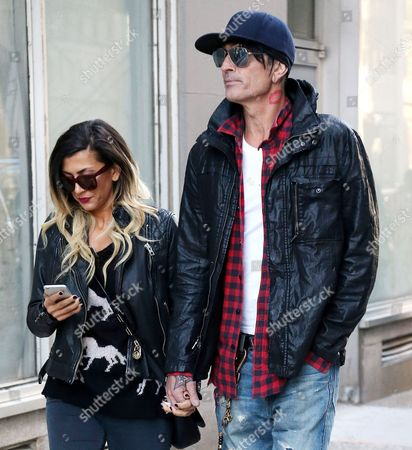 Stock Picture of Tommy Lee and fiancee Sofia Toufa