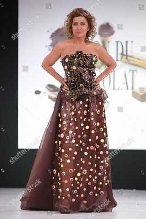 Corinne Touzet walks the runway and wears a chocolate costume