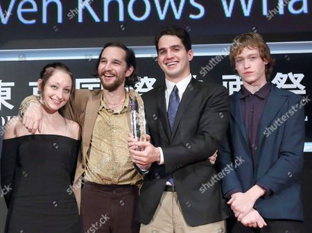 Arielle Holmes, Joshua Safdie, Ben Safdie, Caleb Landry Jones of the film 'Heaven Knows What' celebrated the award for 'Tokyo Grand Prix'