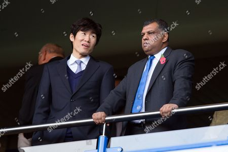 Ji-Sung Park watches from the stands with QPR Chairman Tony Fernandes