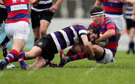 Sam Cronin of Clontarf tackled by James Thornton of Terenure