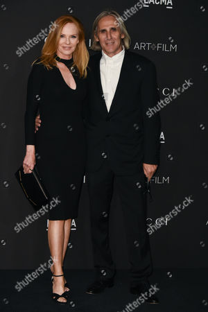 Stock Photo of Marg Helgenberger and Alan Finkelstein