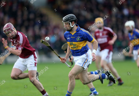 Stock Photo of Portaferry's Ciaran Coulter in action against Cushendall's Paddy Burke