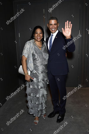 Obama impersonator Reginald Brown Brown posing with a fan.