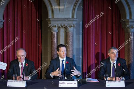 Sir Richard Leese, The Chancellor of the Exchequer, George Osborne MP and Lord Peter Smith at Manchester Town Hall signing a deal to devolve power to Greater Manchester, including giving the city a Mayor and greater control over its finances.