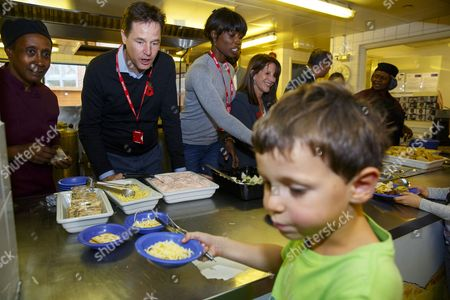 Nick Clegg, Lorraine Pascale and Lynne Featherstone serving lunch to school children