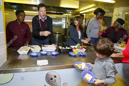 Nick Clegg, Lynne Featherstone and Lorraine Pascale serving lunch to school children