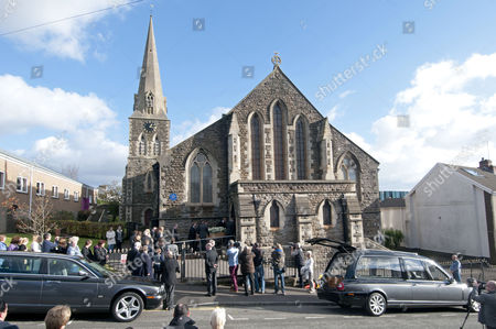 Stock Image of The coffin of Alvin Stardust arrives for his funeral in the St Thomas district of Swansea this afternoon, the same church that he married local girl Julie Paton in the 1990's.