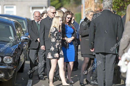 Woman believed to be Sophie Jewry (in blue dress), daughter of Alvin Stardust and Lisa Goddard