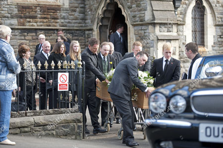 Julie Paton walks behind the coffiin of her late husband Alvin Stardust after his funeral