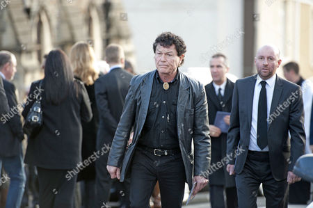 Mourner at the funeral of the late singer Alvin Stardust in St Thomas Church in Swansea today