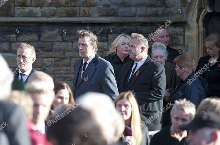 Former members of Alvin Stardust's band leave the church after his funeral in the St Thomas district of Swansea this afternoon