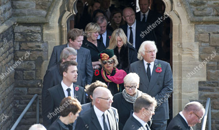 Mourners leave the funeral of the singer Alvin Stardust in St Thomas Church in Swansea today