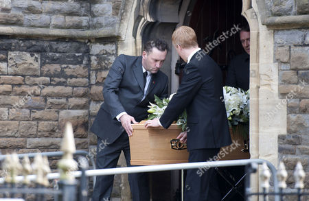 The coffin of the late singer Alvin Stardust is carried from St Thomas church in Swansea today during his funeral