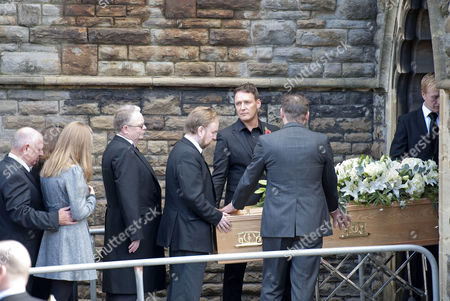 The coffin of Alvin Stardust is carried into St Thomas church in Swansea this afternoon the same church that he married local girl Julie Paton in the 1990's