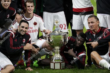 Adel Rami, M'Baye Niang and Philippe Mexes (M) with the trophy