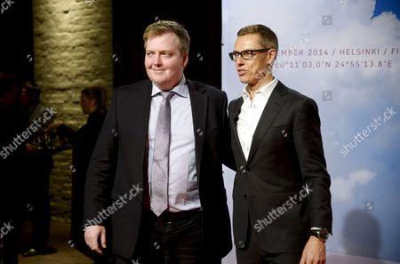 Finnish Prime Minister Alexander Stubb (R) welcomes Prime Minister of Iceland Sigmundur David Gunnlaugsson (L)