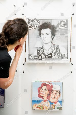 Pizza boxes featuring Sid Vicious and Sophia Loren