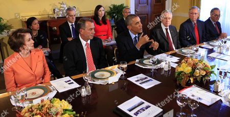 From left to right: U.S. House Minority Leader Nancy Pelosi (Democrat of California), Speaker of the U.S. House John Boehner (Republican of Ohio), Barack Obama, current U.S. Senate Majority Leader Harry Reid (Democrat of Nevada), future U.S. Senate Majority Leader Mitch McConnell (Republican of Kentucky), and U.S. Senator Charles Schumer (Democrat of New York). Also visible at left are National Security Advisor Susan E. Rice, Denis McDonough, Assistant to the President, Katie Fallon, Assistant to the President and Director of Legislative Affairs, and Chief of Staff and John Podesta, Counselor to the President.