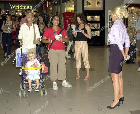ULRIKA JONSSON WITH DAUGHTER BO PASSING BA INFORMATION ASSISTANT JAYNE CONNERY WHO ALSO HAD A FLING WITH SVEN GORAN ERIKSSON