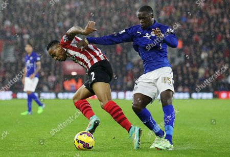 Nathaniel Clyne of Southampton is pushed over by Jeffrey Schlupp of Leicester City.