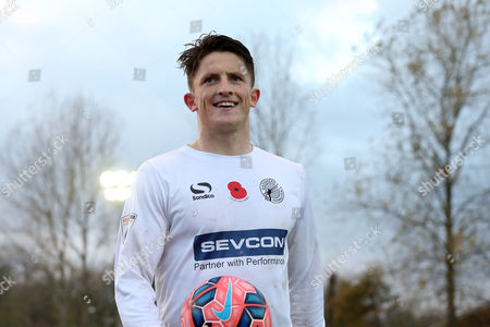 Stock Photo of Rob Ramshaw of Gateshead smiles as he leaves the pitch with the match ball after scoring a hat-trick.