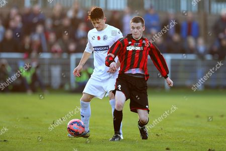 Stock Picture of Niall Green of Norton United competes with Rob Ramshaw of Gateshead