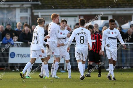 Rob Ramshaw of Gateshead, 3rd left, is congratulated by team mates  after scoring a hat-trick.