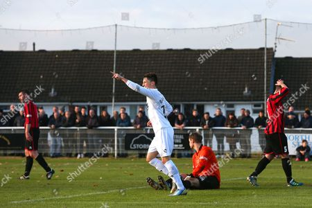 Norton United players look dejected as Rob Ramshaw of Gateshead celebrates scoring hissecond goal. 0-3